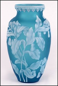 A Thomas Webb & Sons Cameo Glass Vase. Baluster-Form Blue Vase with Flared Rim and having Flowering Vines with Leaves and a Single Butterfly in White Overlay. 8 Inches in Height Circa 1880