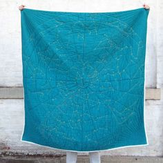 From Haptic Lab, the Constellation Quilt combines enduring craft technique with the mysteries of the universe to create a modern heirloom that also serves as a functional art object. It can be draped on a chair or couch, or folded on the edge of a bed. Quilting Projects, Quilting Designs, Sewing Projects, Embroidery Designs, Embroidery Kits, Quilting Ideas, Constellation Quilt, French Knot Embroidery, Quilt Modernen