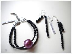 Handmade Jewelry Rg: Earrings and bracelet with purple pearl and black beads