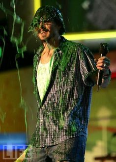 Johnny Depp covered in slime because some heathen children demanded it.