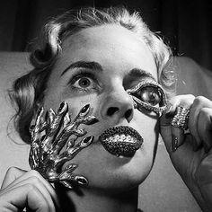 1949.  Salvador Dali and Elsa Schiaparelli Jewelry Collaboration. Elsa Schiaparelli was influenced by Surrealist art. Salvador Dalí was a prominent surrealist painter born in Figueres, Catalonia, Spain. Photo by ?