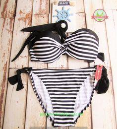 Size: M - L  Bust size: 34-38 No. Produk: 30101510029 Basic color: Putih  Model: Bikini - two piece  Fabric: Nylon - Polyester  Price: Rp. 110.000,- -------------------------------------- Contact: (e): pimpimbikini@gmail.com (p): +628176611176 / +628121057360