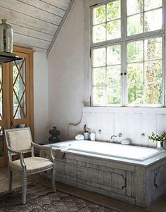 """Rustic Master Bath retreat with tub surround constructed with old barn wood.  If you look closely you'll notice the """"backsplash"""" for lack of a better wood that gives the impression of a french wall fountain. Nice detail."""