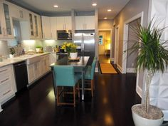 A wall was removed to enlarge the kitchen and bring it forward in the floor plan.