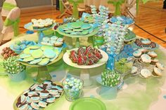 napkins, stands made out of glasses and plates, cute and easy desserts..do in wedding colors