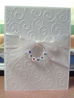 wedding card Love this as a possible idea for a wedding invitation or save-the-date: wine glass ring with alpha beads. From Heart Prints, item using the Cuttlebug embossing folder D-vine Swirls. Wedding Shower Cards, Card Wedding, Bridal Shower, Baby Shower, Engagement Cards, Wedding Anniversary Cards, Happy Anniversary, Embossed Cards, Wedding Card Templates