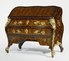 Writing Desk; Abraham Roentgen (German, 1711 - 1793); Germany; about 1760; Oak and fir veneered with walnut, tulipwood, rosewood, cherry, boxwood, cedrela, ebony, and ivory; gilt-bronze mounts; brass hinges and stringing; iron locks and hardware.