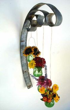 Unique/funky hanging candle/flower holder made from reclaimed wine barrel rings . Unique/funky hanging candle/flower holder made from reclaimed wine barrel rings and recycled glass