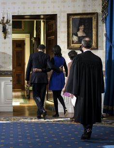President Barack Obama walks with his daughter Malia as first lady Michelle Obama and daughter Sasha and Chief Justice John Roberts as they leave the Blue Room after being oficially sworn-in by Chief Justice John Roberts, back in the Blue Room of the White House during the 57th Presidential Inauguration in Washington, Sunday, Jan. 20, 2013. (AP Photo/Brendan Smialowsi, Pool)