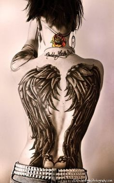 THE GIRL WITH THE WINGS ON HER BACK.