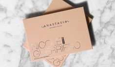 After weeks of teasing this partnership, the Anastasia Beverly Hills x Nicole Guerriero collab has finally been revealed. Well, sort of. The two beauty partners finally showed off their new product on Instagram, and fans are loving it already. What's