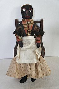 19th C. Black cloth doll with original clothes (