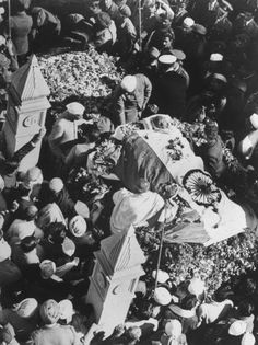 Margaret Bourke-White |  Gandhi's five-hour funeral procession stretched over five and a half miles through the streets of Old and New Delhi, and included some 4,000 troops and more than a million mourners, 1948
