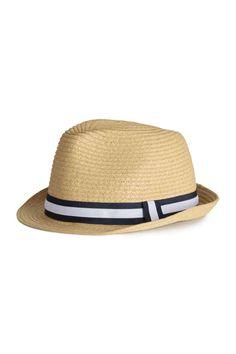 6799db9d23281 Sombrero de paja  Sombrero en paja de papel trenzada con cinta de grosgrain  alrededor de