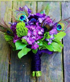Beautiful peacock wedding bouquet.  Purple is my energy color!! :) makes me happy!