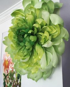 Taking inspiration from the beautiful tones of green to create something different. Giant wall hanging crepe paper sculpture #homedecor #paperflowers #crepepaper #green #wallart #papersculpture #handmade #visualmerchandising #interiordecor #interiorstyling