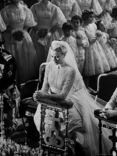 Grace Kelly praying during her Catholic wedding ceremony to Prince Rainier of Monaco. The ceremony was held at St. Nicholas Cathedral.