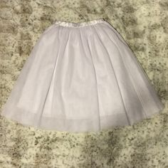 White tulle skirt Beautiful! Reposh! Wore it once for a event :). Now I want a red one for everyday wear. Feel free to make a offer! Skirt goes to my calves and I am five six. Elastic satin waist band. 30' waist. Not j crew J. Crew Skirts Midi
