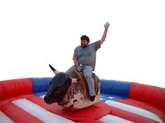 mechanical bull from Phantom Entertainment at www.djphantom.com/mechanicalbull.htm Moon Bounce, Mechanical Bull, Things That Bounce, Entertainment, Party, Chair, Parties, Entertaining