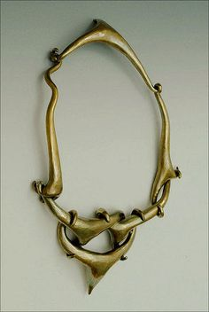 Puzzle Necklace ~ Steve Shelby ~ recycled scaps of brass sheet, hammer-formed into branched spiculums