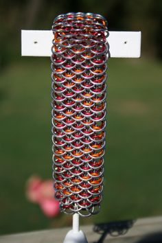 Dragonback (I think!) chainmaille weave. The colors really pop. Pretty, elegant, and bold.