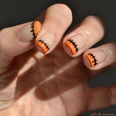 Halloween manicure. Would be even better with green tips instead of orange for a Frankenstein's monster theme!