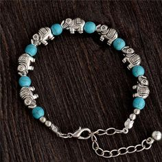 support #threatened #elephants by getting our #beautiful turquoise elephant bracelet only available at savingendangeredanimals.com