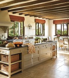 La Mia Bella Cucina-love the extra long island counter, and the wood accents