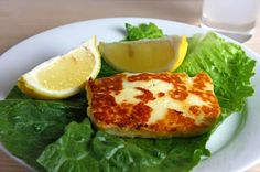 Saganaki - 1 tablespoon butter,  1 pound Halloumi cheese (sliced about 1/4 inch thick),  1 lemon (juice and zest)