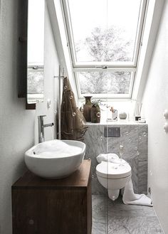 Small bathroom with skylight and grey marble by Daniella Witte