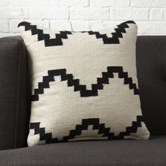 "Shop 16"" Zbase Zig Zag Pillow.   Cotton yarn weaves a graphic interpretation of a traditional kilim pattern.  Bold design with neutral palette perfectly layers with almost any decor.  Reverses to 100% cotton in solid ivory."
