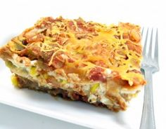 Skinny Lasagna`Ole...This spectacular Mexican layered casserole is both hearty and healthy. It's loaded with lean protein from the chicken, reduced-fat cottage cheese and fat-free refried beans. The skinny skinny for 1 serving, 239 calories, 3 grams of fat and 6 Weight Watchers POINTS PLUS.