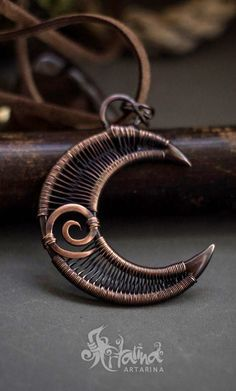 Copper crescent moon wire wrapped pendant.
