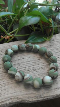 Check out this item in my Etsy shop https://www.etsy.com/listing/265254823/deez-beadz-earthtone-green-brown-glow-in