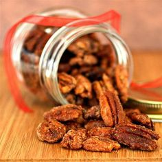 Glazed cinnamon pecans get a little spicy kick thanks to cayenne pepper. Make these seasoned nuts for a quick and easy gift or snack. Cinnamon Pecans, Spiced Pecans, Roasted Pecans, Candied Pecans, Sugar Coated Pecans, Easy Make Ahead Appetizers, Appetizer Recipes, Costco Appetizers, Mini Appetizers