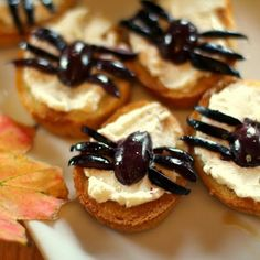 These spooky nibbles of goat cheese and black olives on a toasted baguette make for a delicious and easy hor'dourve, or fun, family snack.