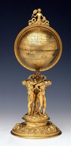 Terrestrial table globe - by Reinhold, Johann -brass; enamel paint; punched; brass gilt. National Maritime Museum