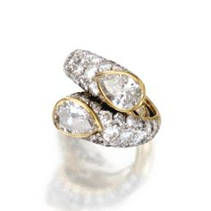 18 KARAT GOLD, PLATINUM AND DIAMOND RING, DAVID WEBB Of crossover design set with 2 pear-shaped diamonds weighing approximately 2.40 carats, accented by round and single-cut diamonds weighing approximately 3.50 carats, size 5¼, signed Webb.