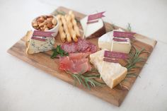 Savory accents like prosciutto and salami beef up an ordinary cheese board