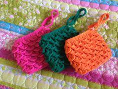 Crocheted crocodile stitch wristlets.