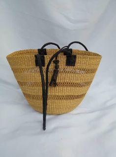 woven African basket/ basket for her/ African gift/ double handle strip/ Leather handle basket/Ghana basket/ leather elephant grass baskets/ Baskets On Wall, Wicker Baskets, Woven Baskets, Winter Bedroom Decor, Handmade Market, Market Baskets, Leather Handle, Ghana, Basket Weaving