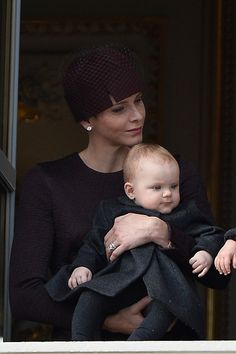 Princess Charlene of Monaco and Princess Gabriella greet the crowd from the palace's balcony during the Monaco National Day Celebrations on November 19, 2015 in Monaco, Monaco