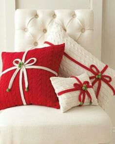 I already have a white bedspread I could make pillows like these with old sweaters cute idea