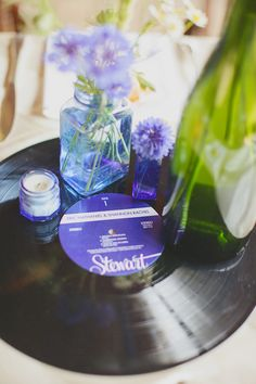 Personalized labels for vinyl records. I used these as centerpieces for my wedding, but you use them in a ton of different ways. Here's the tutorial: http://shananasplit.tumblr.com/post/40654757014/how-to-put-your-own-design-on-a-vinyl-record-label