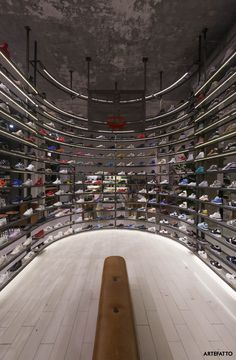 Artefatto design studio has transformed a former insurance office in Milan (Piazza Diaz) into a multi-brand store, providing well-curated selections of some of the best sneaker releases and streetwear drops. The masterpiece of the interior is the curved cage used as a shelving unit from both side. Concrete resin floor and the overall industrial style marks this shoe shop as a landmark of the Milanese scene.