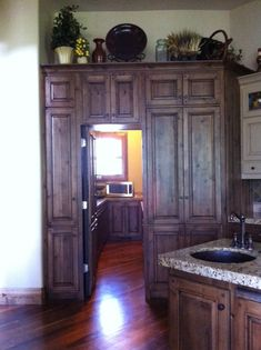 hidden cabinet pantry. This is awesome!