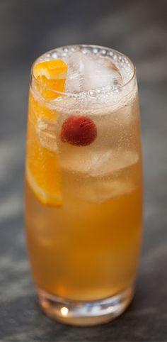Charlie Mackenzie Collins •Splash of absinthe •Ice •1½ ounces Johnnie Walker Double Black™ •½ ounce lemon juice •½ ounce simple syrup •1 ounce club soda •½ orange wheel •1 cherry