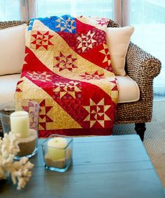 Salute Betsy Ross and Martha Washington with a pariotic, flag-inspired quilt.  The quilt is made with 50 two-color Martha Washington Star blocks.