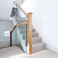 This striking transformation combines a contemporary clear glass balustrade with a solid oak handrail for a timeless look. Oak Handrail, Stair Banister, Timber Staircase, House Staircase, Modern Staircase, Staircase Design, Staircase Ideas, Hallway Ideas, Stair Idea