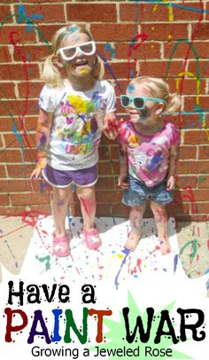 PAINT WAR- Head outside with a bunch of paint, brushes, and balls. Then, have a war. The person who covers the other in the most paint wins. You can squirt the paint straight from the bottle at each other, or throw balls that have been dipped in paint. My kids also loved splattering paint at each other using brushes. This is worth it for the photos alone, and was seriously a BLAST!!! The whole family can get in on the fun, too!
